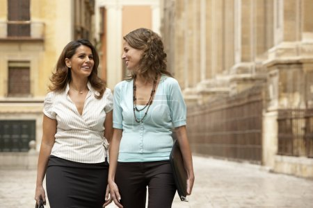 Businesswomen walking through town