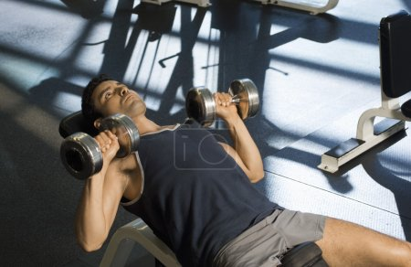 Man Using Dumbbells