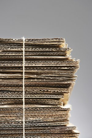 Photo for Bundle of corrugated cardboard tied with string close-up full frame - Royalty Free Image