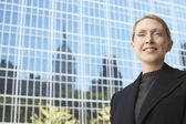 Businesswoman outside office building