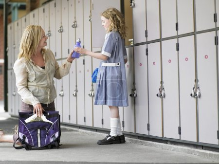 Mother with daughter and school bag