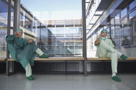 Surgeons in hospital corridor