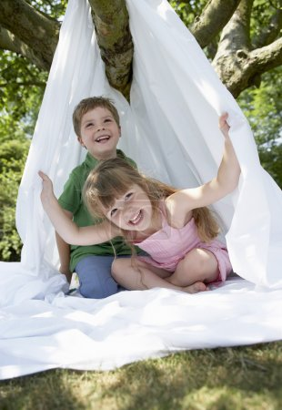 Boy and girl in handmade tent