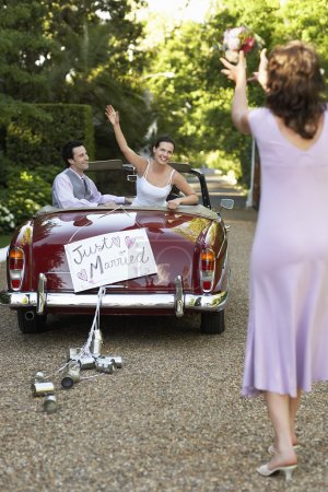 Bride Tossing Bouquet from Car