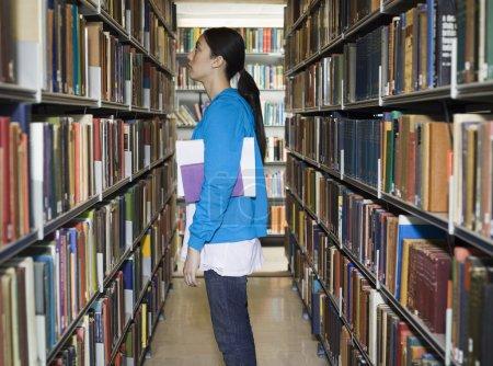 woman standing near bookshelf