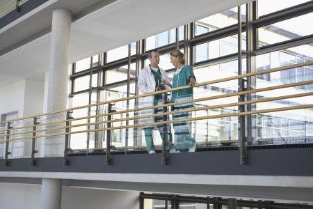 Physicians talking on Balcony