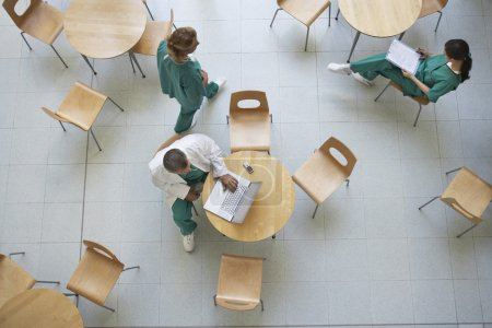 Physicians sitting in cafeteria
