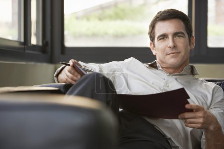 Relaxed successful businessman
