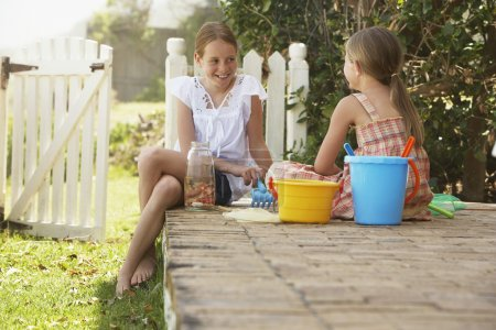 girls playing with buckets