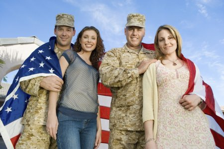 Photo for Military couples embracing outdoors - Royalty Free Image