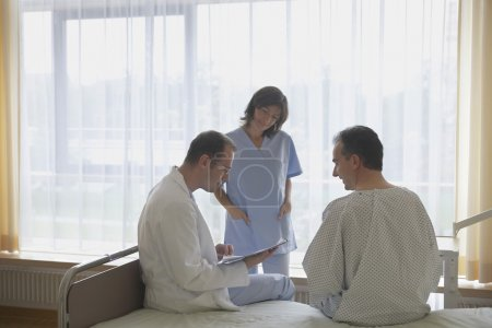 Doctor and Nurse Consulting with Patient