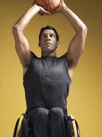 Paraplegic athlete with basketball