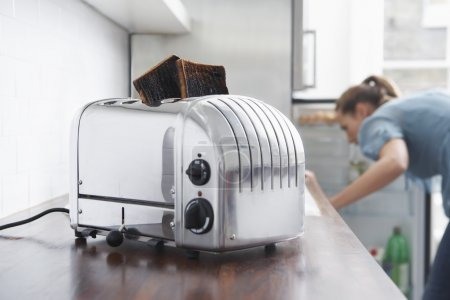 Burned toasts in toaster