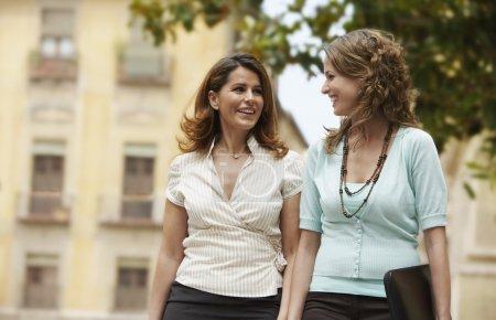 Businesswomen walking together