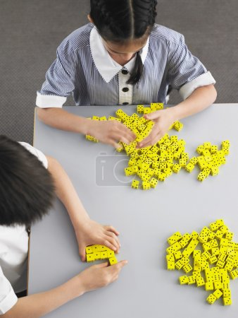 Elementary students playing with dice