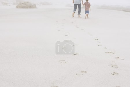 Father and son walking on beach