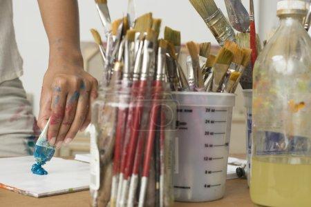 Artist Squeezing Paint