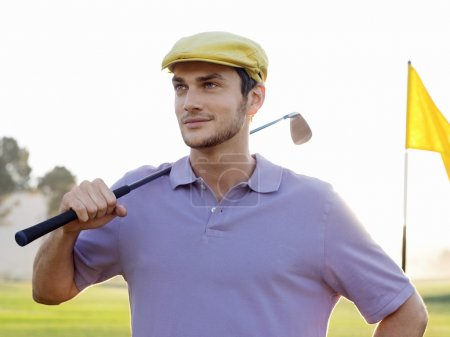 golfer on course with club
