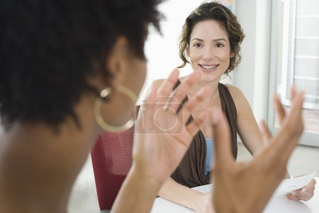 Photo for Young businesswomen during meeting in office - Royalty Free Image