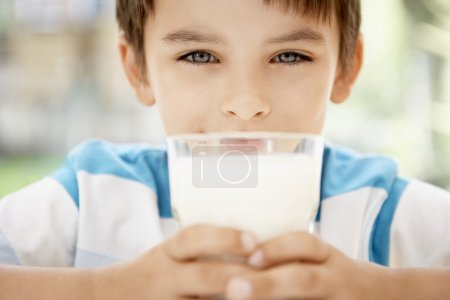 boy holding glass of milk