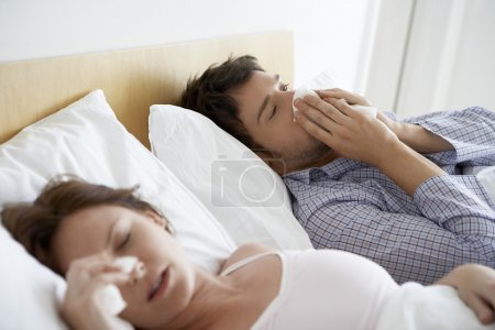 Couple with Colds in Bed