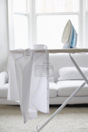 White shirt on ironing board