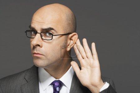 Balding man listening closely