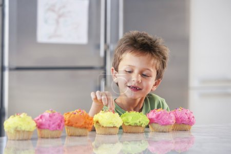 Boy Sneaking a Bite of Cupcake