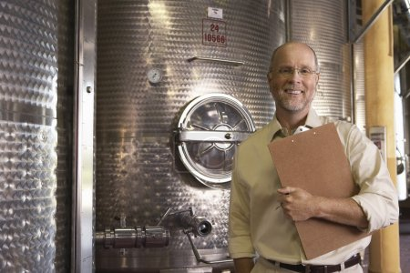 Winemaker with Wine Vats