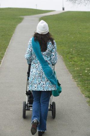 Mother pushing stroller