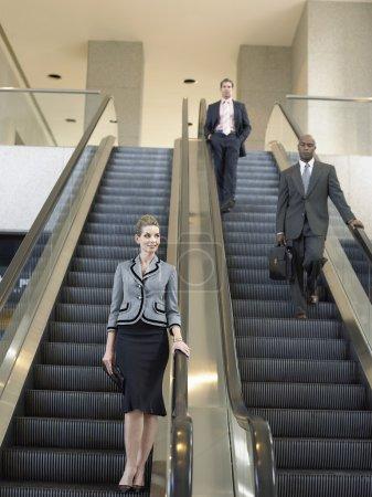 Businesspeople on escalators
