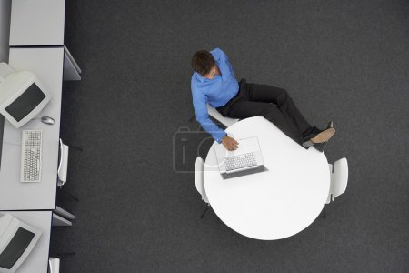 Man Using Laptop in computer room