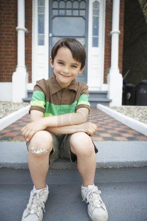 Boy With Bandaid on Knee