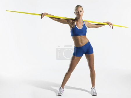 Female athlete holding javelin