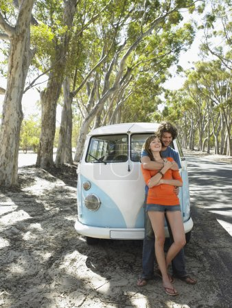 couple embracing over camper van