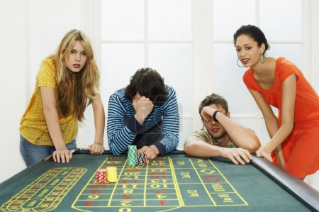 Photo for Group of friends losing on roulette table - Royalty Free Image