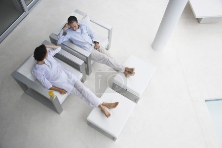 Couple Resting in Chairs