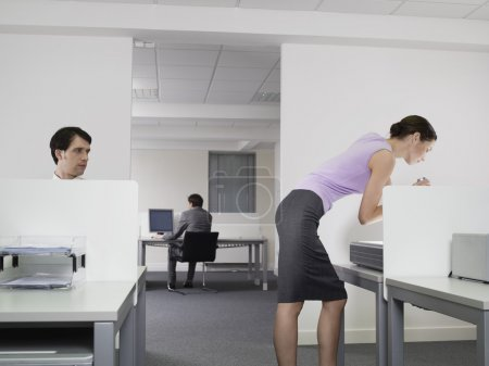 Businessman watching female colleague