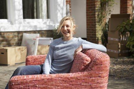 woman sitting on sofa outdoor