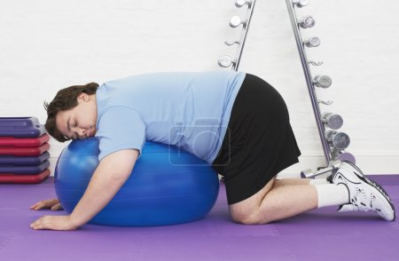 Man sleeping on Exercise Ball