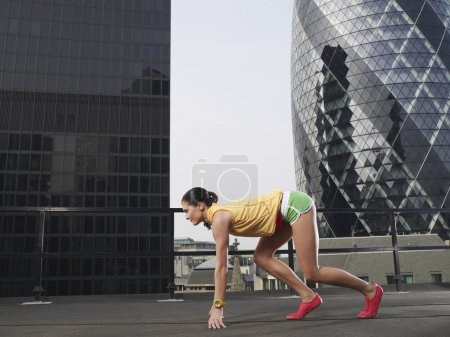 Photo for Female Sprinter in Starting Position - Royalty Free Image