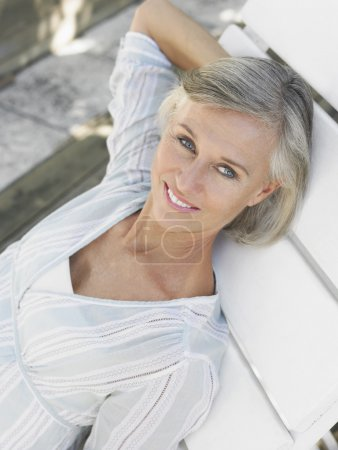 Photo for Woman reclining on sun lounger, close up - Royalty Free Image