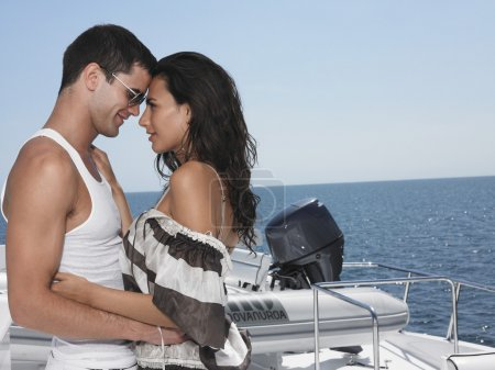 Couple embracing on yacht