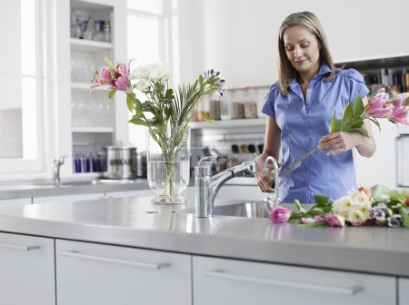 Woman Arranging Floral Bouquet