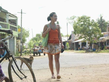 Woman walking on rural road