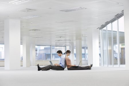 Office workers using laptops