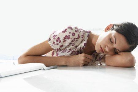 Woman Resting on Desk