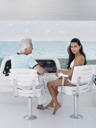 Man and young woman sitting