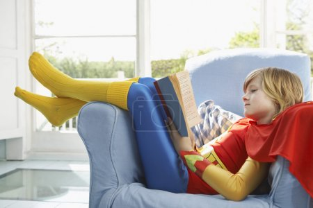 Boy  reading in armchair