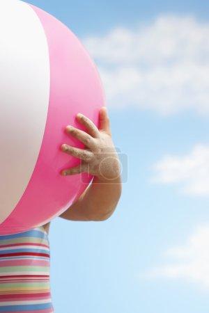 little Girl hand holding beach ball